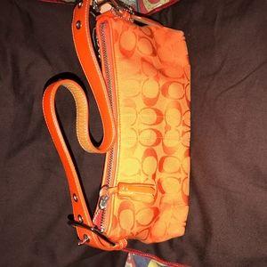 COACH Orange Clutch